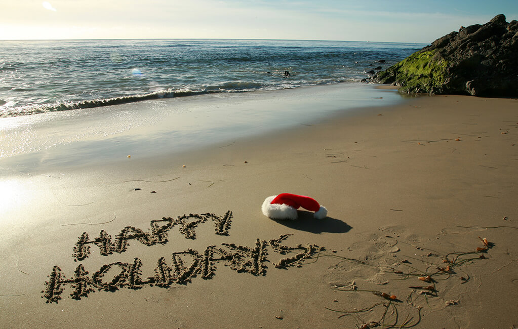 Happy-Holidays-Written-in-Sand-Web